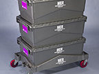 Four plastic totes stacked on dolly